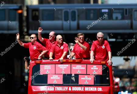 Stan Bowman, Al Macisaac, Jay Blunk, Rocky Wirtz, President Jim McDonough The Chicago Blackhawks' executive staff, from left, General Manager Stan Bowman, Vice presidents Al Macisaac, Jay Blunk, owner Rocky Wirtz, and President Jim McDonough, ride in the 2013 Stanley Cup Champion victory parade down Washington Street in Chicago. The Blackhawks celebrate the team's second championship in four years