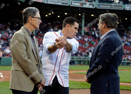 Billy Bean, John Henry, Tom Werner Billy Bean, former Major League ballplayer and current MLB Vice President, Social Responsibility & Inclusion, swings an imaginary bat as Boston Red Sox owners John Henry, left, and Tom Werner watch before a baseball game between the Red Sox and the Toronto Blue Jays at Fenway Park, in Boston