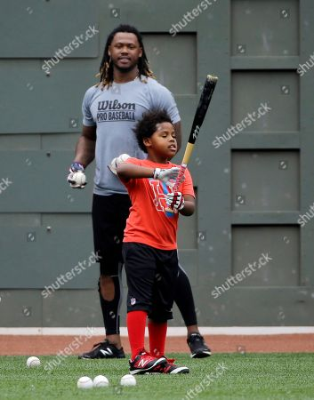 Stock Image of Hanley Ramirez Boston Red Sox's Hanley Ramirez plays ball with his son, Hansel in the outfield before a baseball game against the Toronto Blue Jays at Fenway Park, in Boston