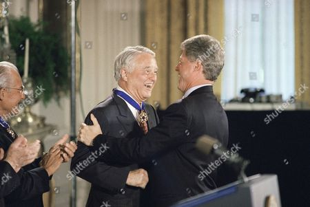 "Sargent Shriver, William Clinton, Bill Clinton House Minority Leader Bob Michel of Illinois, left, applauds as President Bill Clinton congratulates Robert Sargent Shriver after awarding him the Presidential Medal of Freedom during a ceremony in the East Room in the White House in Washington in afternoon, . Clinton, carrying out ""one of the great pleasures of the presidency,"" awarded the nation's highest civilian honor on Monday to nine Americans, including Michel and Shriver"