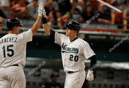 Logan Morrison, Gaby Sanchez Florida Marlins' Logan Morrison (20) is congratulated by Gaby Sanchez (15) after hitting a solo home run during a baseball game against the Atlanta Braves in Miami
