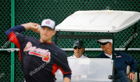 John Hart, Jim Johnson, John Schuerholz Atlanta Braves president of baseball operations, John Hart, right, and president John Schuerholz, left, watch as pitcher Jim Johnson throws the ball during a spring training baseball workout, in Kissimmee, Fla