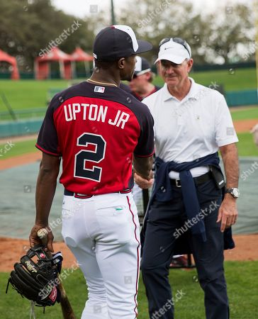Melvin Upton Jr., John Hart Atlanta Braves' Melvin Upton Jr. wears a jersey with his new name after having it changed on the Braves' roster from B.J. Upton to Melvin Upton Jr., while greeting John Hart, president of baseball operations, during a spring training baseball workout, in Kissimmee, Fla