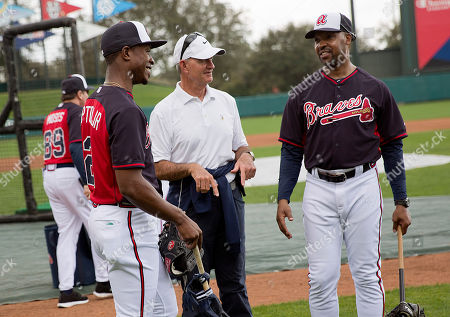 Melvin Upton Jr., John Hart, Bo Porter Atlanta Braves' Melvin Upton Jr., left, wearing a jersey with his new name after having it changed on the Braves' roster from B.J. Upton to Melvin Upton Jr., talks with John Hart, president of baseball operations, center, and third base coach Bo Porter during a spring training baseball workout, in Kissimmee, Fla
