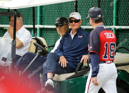 John Hart, Carlos Tosca, John Schuerholz Atlanta Braves president of baseball operations, John Hart, center, talks with bench coach Carlos Tosca, right, while sitting in a golf cart with president John Schuerholz, left, during a spring training baseball workout, in Kissimmee, Fla
