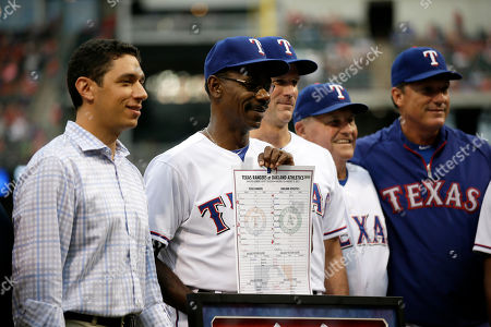 Jon Daniels, Ron Washington, Jackie Moore, Dave Magadan, Dave Anderson Texas Rangers President of Baseball Operations and General Manager Jon Daniels poses with manager Ron Washington, Dave Anderson, Jackie Moore, and Gary Pettis, right, during a ceremony before a baseball game against the Milwaukee Brewers, in Arlington, Texas. Washington became the winningest manager in franchise history after a recent win against the Oakland Athletics