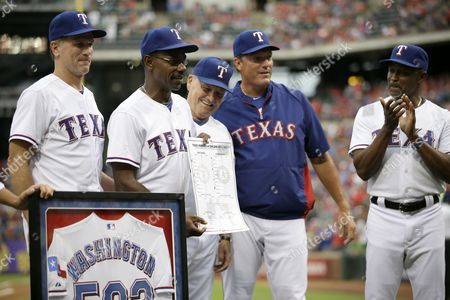 Ron Washington, Dave Anderson, Jackie Moore, Dava Magadan, Gary Pettis Texas Rangers manager Ron Washington, second from left, poses with base coach Dave Anderson, left, bench coach Jackie Moore, from middle, batting coach Dave Magadan and base coach Gary Pettis, right, during a ceremony before a baseball game against the Milwaukee Brewers, in Arlington, Texas. Washington became the winningest manager in franchise history after a Aug. 4, 2013, win against the Oakland Athletics