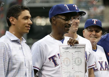 Jon Daniels, Ron Washington, Jackie Moore, Dave Anderson Texas Rangers President of Baseball Operations and General Manager Jon Daniels, left, poses with manager Ron Washington, Dave Anderson and bench coach Jackie Moore, right, during a ceremony before a baseball game against the Milwaukee Brewers, in Arlington, Texas. Washington became the winningest manager in franchise history after a Aug. 4, 2013, win against the Oakland Athletics