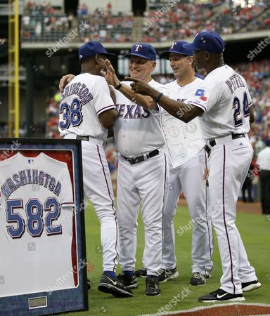 Ron Washington, Gary Pettis, Jackie Moore, Dave Anderson Texas Rangers manager Ron Washington, left, exchanges hand shakes with coaching staff members Jackie Moore, from second left, Dave Anderson, and Gary Pettis (24) during a ceremony before a baseball game against the Milwaukee Brewers, in Arlington, Texas. Washington became the winningest manager in franchise history after a Aug. 4, 2013, win against the Oakland Athletics