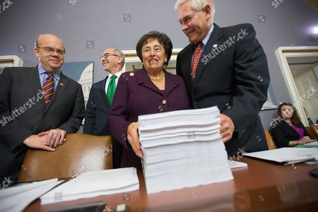 Pete Sessions, Nita Lowey, James McGovern House Rules Committee Chairman Pete Sessions, R-Texas, right, welcomes Rep. Nita Lowey, D-N.Y., the ranking member of the House Appropriations Committee, and Rules Committee member Rep. James P. McGovern, D-Mass., far left, as they gather around a printout of the $1.1 trillion spending bill to fund the government for the 2016 budget year and extend $680 billion in tax cuts for businesses and individuals, at the Capitol in Washington, . President Barack Obama is expected to sign the legislation