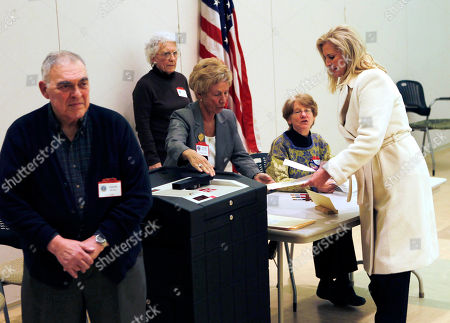 "Stock Picture of Mitt Romney In this, photo, Ann Romney, wife of Republican presidential candidate former Massachusetts Gov. Mitt Romney votes in the Super Tuesday Massachusetts primary at the Beech Street Senior Center in Belmont, Mass., as Maryann Scali, who served with Ann on the Belmont Town Meeting together, watches. Husband Joe Scali is at front left. To the yearbook editors at the all-girl Kingswood School, Ann Lois Davies' destiny seemed pretty obvious. ""The first lady,"" the entry beside the stunning blond beauty's photo in the 1967 edition of ""Woodwinds"" concluded"