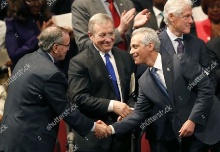 Richard Daley, Dick Durbin, Rahm Emanuel, Bill Clinton Chicago Mayor Rahm Emanuel, second from right, shakes the hand of former mayor Richard M. Daley, left, during city government inaugural ceremonies, in Chicago. Stand with Daley and Emanuel are Sen. Dick Durbin, center, and President Bill Clinton