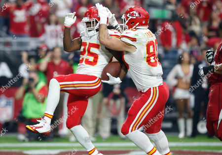 Jamaal Charles, Anthony Fasano Kansas City Chiefs running back Jamaal Charles (25) celebrates his touchdown with teammate Anthony Fasano (80) during the first half of an NFL football game against the Arizona Cardinals, in Glendale, Ariz