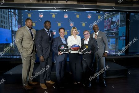 Stephen Bowen, Roman Oben, Scott Zeiger, Dawn Hudson, Daniel Lamarre, Deion Sanders Stephen Bowen, left,10-year NFL Veteran, Roman Oben, second from left, 12-year NFL Veteran and Super Bowl Champion, Scott Zeiger, third from left, Cirque du Soleil Theatrical President and Managing Director, Dawn Hudson, third from right, NFL CMO, Daniel Lamarre, second from right, Cirque du Soleil CEO, and Deion Sanders, Pro Football Hall of Famer pose for a photo during a news conference, in New York. Cirque du Soleil is teaming up with the NFL to open an theme park in New York's Time's Square