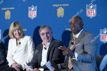 Stock Picture of Dawn Hudson, Daniel Lamarre, Deion Sanders Daniel Lamarre, center, Cirque du Soleil CEO, and Dawn Hudson, left, NFL CMO, listens as Deion Sanders, Pro Football Hall of Famer, speaks during a news conference, in New York. Cirque du Soleil is teaming up with the NFL to open an theme park in New York's Time's Square