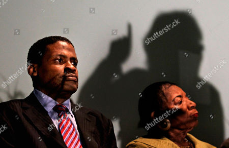 Isaac Farris, Christine King Farris Isaac Farris, left, sits with his mother and sister to Rev. Martin Luther King Jr., Christine King Farris, right, as the shadow of Trina Baynes, chapter president for the Southern Christian Leadership Conference in Henry County, Ga., is cast during a news conference, in Atlanta. Isaac Farris, the former president of the SCLC says he was dismissed from the civil rights group without warning or a chance to rebut any reasons for his ouster. Farris spoke publicly Monday for the first time since the board dismissed him in April from the organization co-founded by his uncle, the Rev. Martin Luther King, Jr., and called for unity