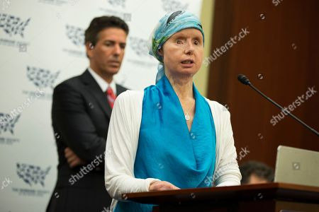 Stock Photo of Wayne Pacelle, Charla Nash Wayne Pacelle, president and CEO of the Humane Society of the United States listens at left as Charla Nash speaks during a news conference on Capitol Hill in Washington, . Nash was mauled by a pet chimp and had to undergo a face transplant. She is now advocating for a bill to be passed that would ban the interstate trade of primates as pets