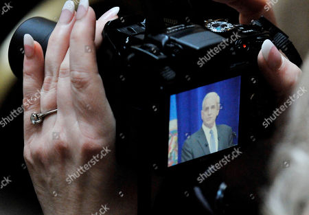Mark Dayton An attendee takes a photo of Minnesota Gov. Mark Dayton as he addresses the inauguration audience after he took the oath of office as Minnesota governor from Supreme Court Chief Justice Lorie Skjerven Gildea in St. Paul, Minn