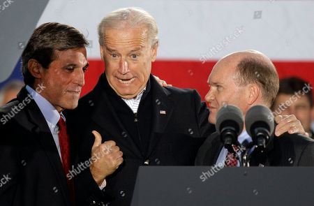 Joe Biden, Chris Coons, John Carney Vice President Joe Biden, center, jokes with Democratic U.S. House candidate John Carney, left, and Democratic U.S. Senate candidate Chris Coons, right, while attending a rally for the Delaware Democratic Party ticket, in Wilmington, Del