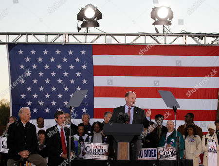 Chris Coons, Joe Biden, John Carney Delaware Democratic U.S. Senate candidate Chris Coons, at podium, delivers remarks during a rally for the Delaware Democratic Party ticket, in Wilmington, Del. At far left is Vice President Joe Biden, and U.S. House candidate John Carney, center