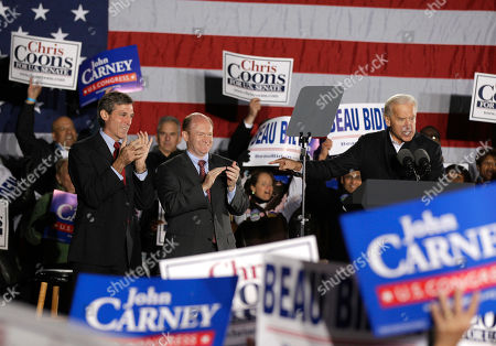 Joe Biden, Chris Coons, John Carney Vice President Joe Biden, right, along with Democratic U.S. House candidate John Carney, left, and Democratic U.S. Senate candidate Chris Coons, middle, during a rally for the Delaware Democratic Party ticket, in Wilmington, Del