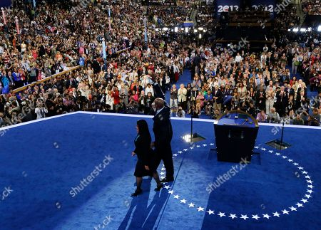 Maya Soetoro-ng, President Barack Obama's sister, and Craig Robinson, First Lady Michelle Obama's brother, leave the stage after speaking at the Democratic National Convention in Charlotte, N.C., on