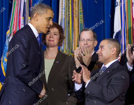 "Barack Obama, Mike Mullen, Zoe Dunning, Eric Alva President Barack Obama shakes hands with former Navy Commander Zoe Dunning, as Joint Chiefs Chairman Adm. Mike Mullen, second from right, and former Marine Staff Sgt. Eric Alva applaud during a signing ceremony for ""don't ask, don't tell"" repeal legislation that would allow gays to serve openly in the military, at the Interior Department in Washington"
