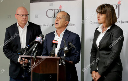 Stock Image of Dominic Kane, Sue Turton, Peter Greste Al Jazeera journalist Peter Greste, center, answers questions during a news conference along with journalist Sue Turton, right and senior producer Dominic Kane, in New York. The three are in the process of requesting a pardon from Egyptian President Abdel Fatah al-Sissi after having been convicted in absentia by Egypt's courts of aiding terrorist organizations by disseminating false news