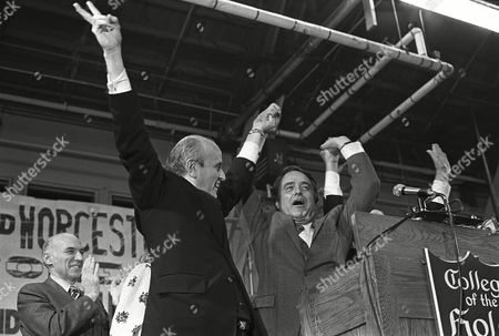 Robert F. Drinan, Sargent Shriver U.S. Rep. Robert F. Drinan, left, and R. Sargent Shriver, Democratic candidate for vice president, riase their hands before a cheering crowd at a Holy Cross College, Worcester, Mass., rally, . Drinan is seeking the congressional seat in the 4th Massachusetts District
