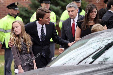 John Edwards Former Democratic presidential candidate John Edwards and his children, Emma Claire, left, Jack, obscured right, and Cate, right, leave the funeral service for Elizabeth Edwards at Edenton Street United Methodist Church in Raleigh, N.C., . Edwards died Tuesday of cancer at the age of 61