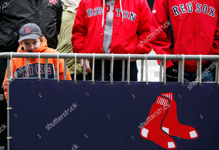 Josh Berman, 7, of Framingham, Mass., watches as equipment is loaded onto a truck outside Fenway Park in Boston on Truck Day, . Truck Day is the day when the Red Sox moving van gets loaded at Fenway Park and begins the drive to the team's spring training baseball camp in Fort Myers, Fla. It has become a sign that spring is just around the corner