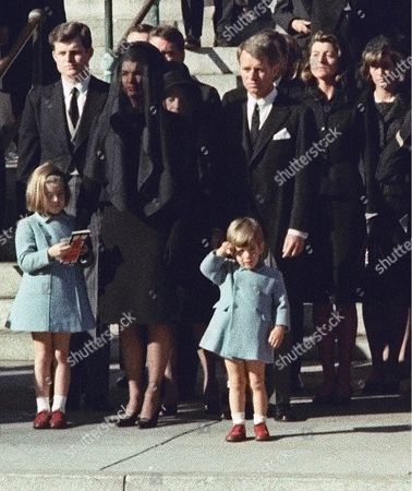 Three-year-old John F. Kennedy Jr., salutes his father's casket in Washington, three days after the president was assassinated in Dallas. Widow Jacqueline Kennedy, center, and daughter Caroline Kennedy are accompanied by the late president's brothers Sen. Edward Kennedy, left, and Attorney General Robert Kennedy. A documentary film on John Kennedy Jr.'s life opens, in select theaters. It also airs on Spike TV at 9 p.m. EDT on Aug. 1, and a DVD release is set for Aug. 16
