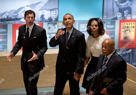 """Barack Obama, Michelle Obama, Mark Updegrove, John Lewis From left, LBJ Presidential Library Director Mark Updegrove, President Barack Obama, first lady Michelle Obama and Rep. John Lewis, D-Ga., arrive in the Great Hall at the LBJ Presidential Library in Austin, Texas, to attend a Civil Rights Summit to commemorate the 50th anniversary of the signing of the Civil Rights Act. Updegrove, said the film, """"Selma,"""" that opens in theaters, incorrectly portrays President Lyndon B. Johnson as an obstructionist to the Rev. Dr. Martin Luther King Jr. """"Selma"""" is based on the 1965 marches from the Alabama cities of Selma to Montgomery that were led by King"""