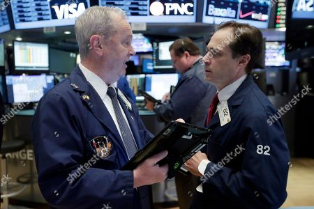 James Riley, Dudley Devine Trader James Riley, left, and Dudley Devine talk on the floor of the New York Stock Exchange, . U.S. stocks are opening higher as the market shakes off the latest drop in China