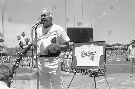 Duke Snider Former Dodger batting great Duke Snider, right, accepts jersey with his number four, retired by the Dodgers, from club President Peter O?Malley at Old timers? Day ceremonies, at Dodger Stadium in Los Angeles. Snider, who hit more homers and drove in more runs than any other Dodger, and led the Dodgers 1955 World Series victory with four homers, will be inducted into the Baseball Hall of Fame next month