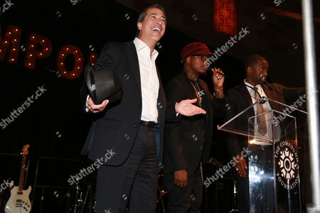 Stock Picture of Marc Leder, Ne-Yo, Jay Pharoah Marc Leder, Event Chair of Fostering A Legacy and CEO of Sun Capital Partners, is seen on stage with Ne-Yo and Jay Pharoah at the Fostering A Legacy Benefit on in New York City