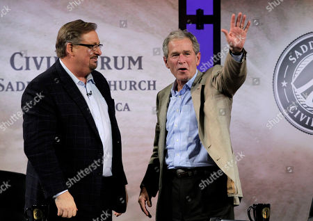 George W. Bush, Rick Warren Former President George W. Bush, right, waves as he is joined by pastor Rick Warren during the Saddleback Civil Forum on Leadership and Service in Lake Forest, Calif