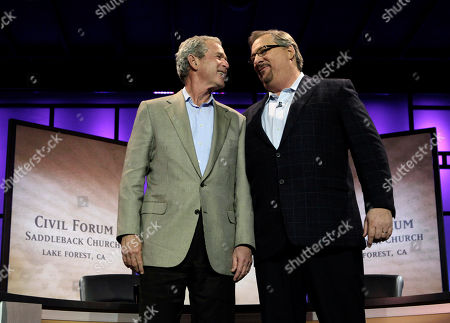 George W. Bush, Rick Warren Former President George W. Bush, left, looks at pastor Rick Warren as they acknowledge audience members during the Saddleback Civil Forum on Leadership and Service in Lake Forest, Calif