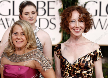 "Darlene Hunt, right, and Jenny Bicks, executive producers of ""The Big C,"" arrive at the Golden Globe Awards, in Beverly Hills, Calif"