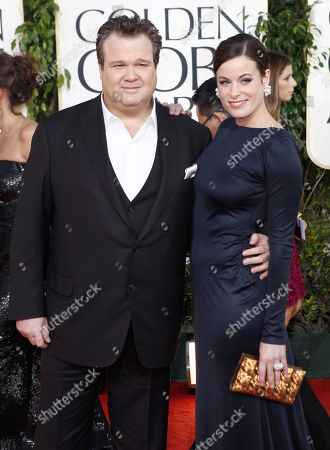 Eric Stonestreet, left, and Catherine Tokarz arrive at the Golden Globe Awards, in Beverly Hills, Calif