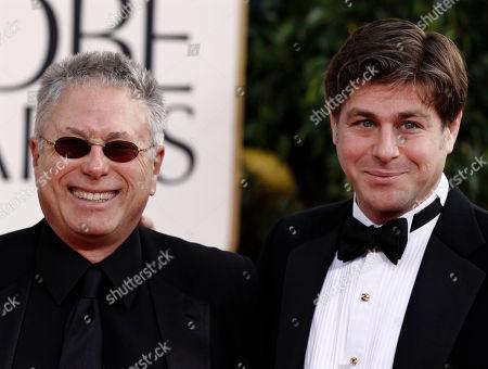 """Alan Menken, left, and Glenn Slater, nominees for Best Original Song for the film """"Tangled,"""" arrive for the Golden Globe Awards, in Beverly Hills, Calif"""