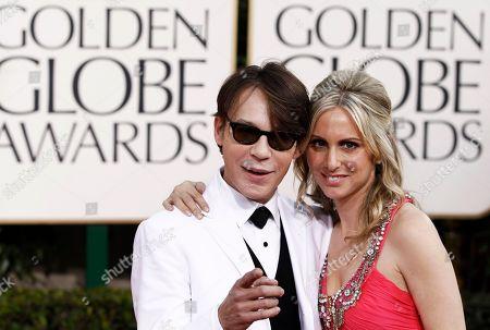 Stock Image of Steve Antin, Stacy Cramer Steve Antin, left, and Stacy Cramer arrive for the Golden Globe Awards, in Beverly Hills, Calif