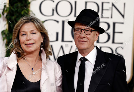 Geoffrey Rush and wife Jane Menelaus arrive before the Golden Globe Awards, in Beverly Hills, Calif