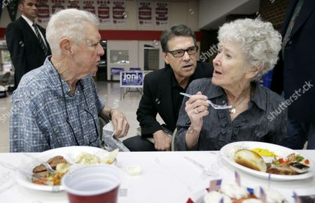 Chris Christie Texas Gov. Rick Perry talks with Dick Dale, left, and his wife Margurite, right, of Algona, Iowa, during a meeting with local party activists, in Algona, Iowa. After his presidential bid crashed in 2012, Iowans now have to decide whether to give Perry another spin