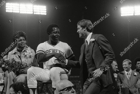 "Henry Aaron, Jack Ford Henry Aaron shakes hands with Jack Ford, son of President Ford, during "" Henry Aaron Night"" at Milwaukee at night on . Jack Ford was representing the President and relayed his congratulations for an outstanding career. Aaron was honored before the Brewer-New York Yankee game"