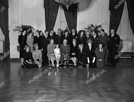 Harry Truman Film stars, who are taking part in Roosevelt birthday ball activities, pose in east room of White House, Washington, D.C., on with President Harry S. Truman and members of his family. Front, left to right: Ilene Woods, Diana Lynn, Margaret Truman, Margaret O?Brien, President Truman, Mrs. Truman, Constance Moore, Dorothy Kilgallen, Eileen Barton. Back, L to R.: Jo Stafford, Lambert, Angela Lansbury, Helen Sioussat, Bracken, Paul Henreid, Zachary Scott, Alexis Cesar Romero, Lucy Munroe, William Bendix, Tecinald Gardiner, Sgt. Harvey stone and Charles Coburn. Stars were entertained at White House for luncheon