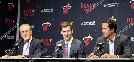 Goran Dragic, Pat Riley, Erik Spoelstra Miami Heat's Goran Dragic, flanked by Miami Heat president Pat Riley, left, and head coach Erik Spoelstra, right, answers a question during a news conference, in Miami. Goran Dragic has signed a five-year deal with the Miami Heat