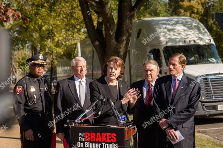 Roger Wicker, Dianne Feinstein, Richard Blumenthal, James P. Hoffa, Walter Armstrong Sen. Dianne Feinstein, D-Calif., center, accompanied by, from left, Vicksburg, Miss. Police Chief Walter Armstrong, Sen. Roger Wicker, R-Miss., International Brotherhood of Teamsters President James P. Hoffa and Sen. Richard Blumenthal, D-Conn., right, speaks during a news conference on the West Front of the Capitol in Washington, to discuss bipartisan opposition to a federal mandate that would allow large trucks to pull double 33-foot trailers on the nation's highways