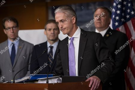 Stock Image of Trey Gowdy, Peter Roskam, Jim Jordan, Mike Pompeo Rep. Trey Gowdy, R-S.C., chairman of the House Select Committee on Benghazi, joined by other Republican members of the panel, discusses the release of his final report on the 2012 attacks on the U.S. consulate in Benghazi, Libya, where a violent mob killed four Americans, including Ambassador Christopher Stevens, at a news conference on Capitol Hill in Washington, . Behind Gowdy, from left, are, Rep. Peter Roskam, R-Ill., Rep. Jim Jordan, R-Ohio, and Rep. Mike Pompeo, R-Kan. Republicans on the panel accuse the Obama administration of stonewalling important documents and witnesses but Democrats say the panel's primary goal is to undermine the presidential candidacy of Hillary Clinton who was secretary of state during the attacks