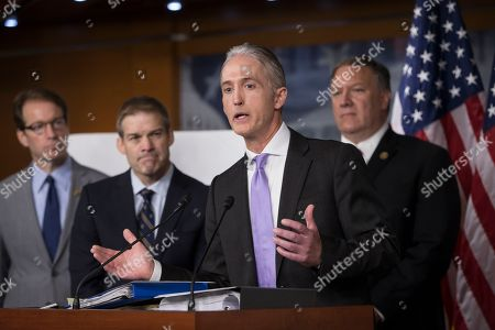 Stock Photo of Trey Gowdy, Peter Roskam, Jim Jordan, Mike Pompeo House Benghazi Committee Chairman Rep. Trey Gowdy, R-S.C., second from right, joined by other Republican members of the panel, discusses the release of his final report on the 2012 attacks on the U.S. consulate in Benghazi, Libya, where a violent mob killed four Americans, including Ambassador Christopher Stevens, during a news conference on Capitol Hill in Washington. From left are, Rep. Peter Roskam, R-Ill., Rep. Jim Jordan, R-Ohio, Gowdy and Rep. Mike Pompeo, R-Kan